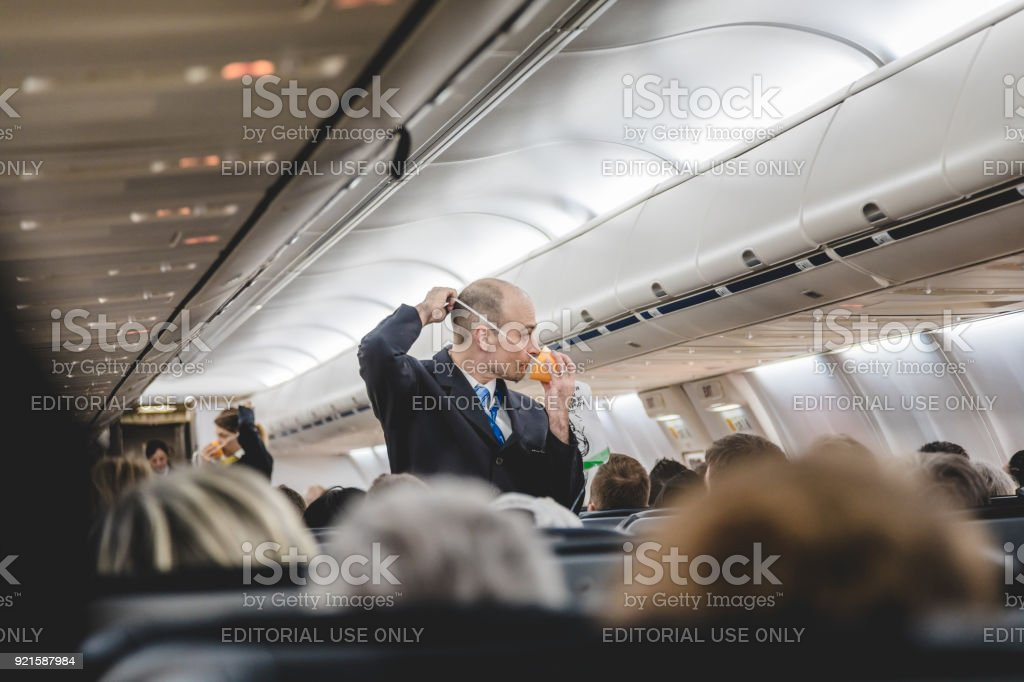 Staff Doing the Emergency Demo before Takeoff from the Interior of Air Transat Airplane in Direction of San Andres Island. stock photo