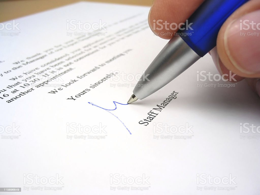 Staff manager signing a letter royalty-free stock photo