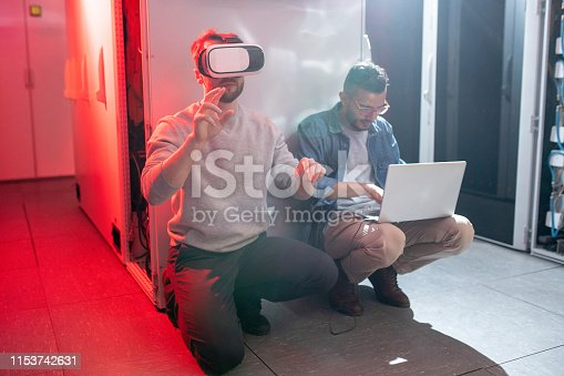 istock Staff of IT company in server room 1153742631