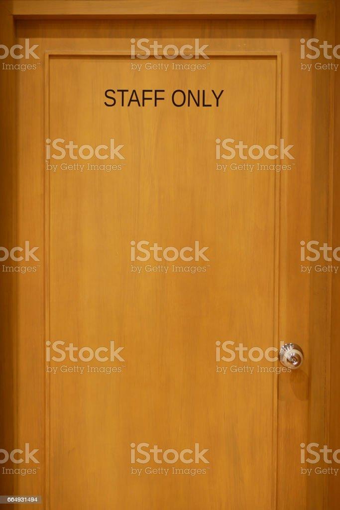 Staff only wood door stock photo