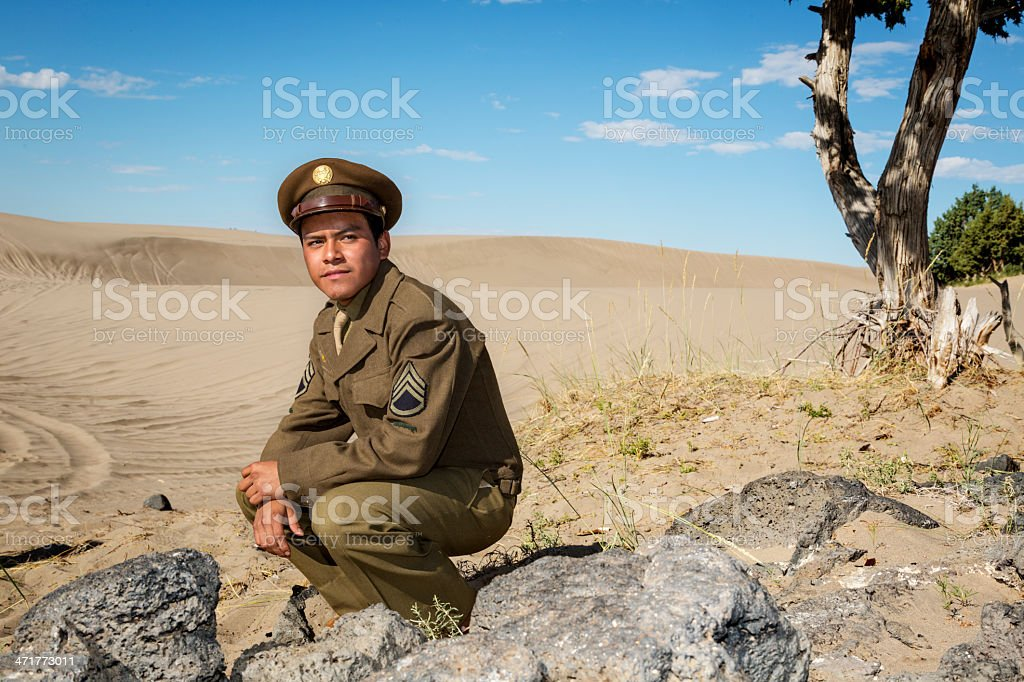 WW2 Staff Sergeant rests in the desert sands royalty-free stock photo
