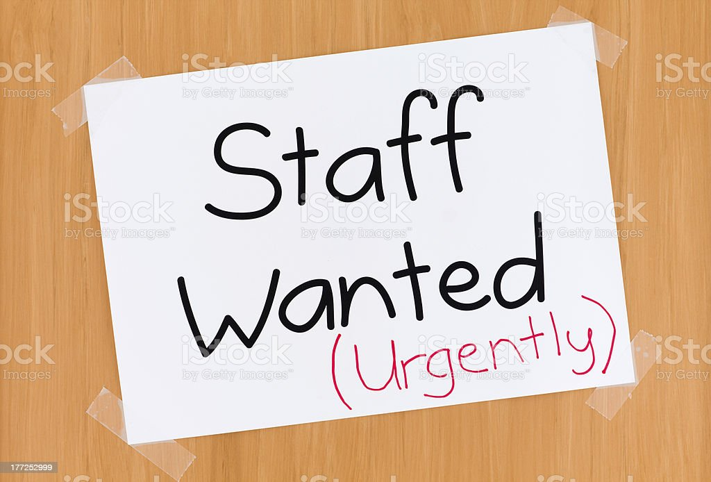 Staff Wanted Urgently Sign on Door stock photo
