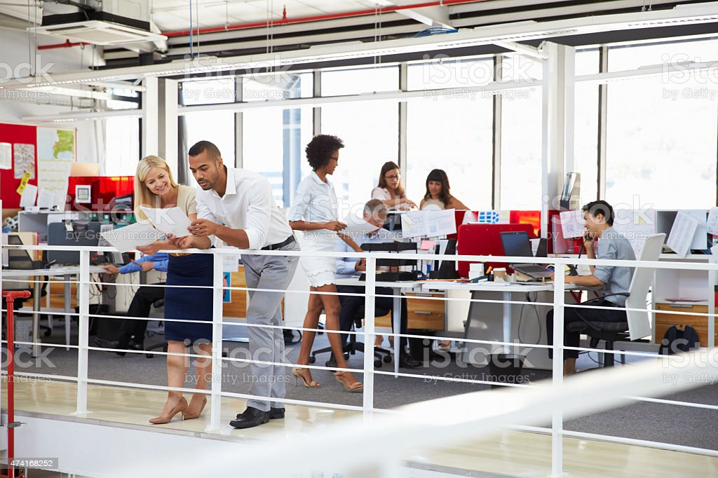 Staff working in a busy office mezzanine stock photo