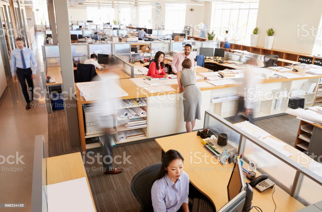 Staff working in a busy open plan office royalty-free stock photo