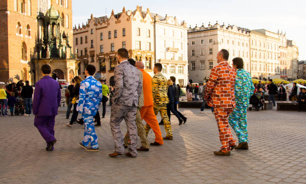 Stag party in brightly coloured clothing, Krakow. stock photo