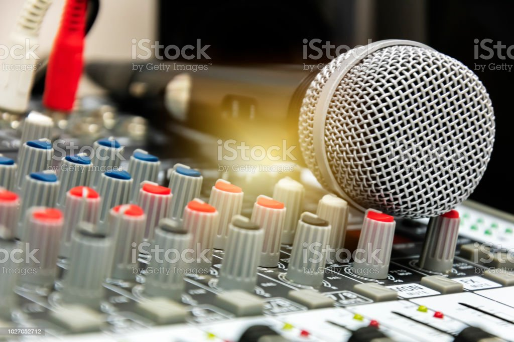 Stage control.Hand adjusting audio mixer. stock photo