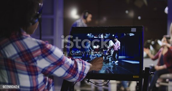 istock Stage director watching show in record 922950424