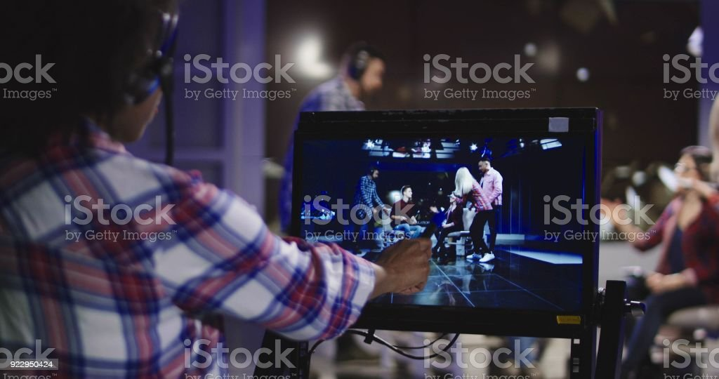 Stage director watching show in record stock photo