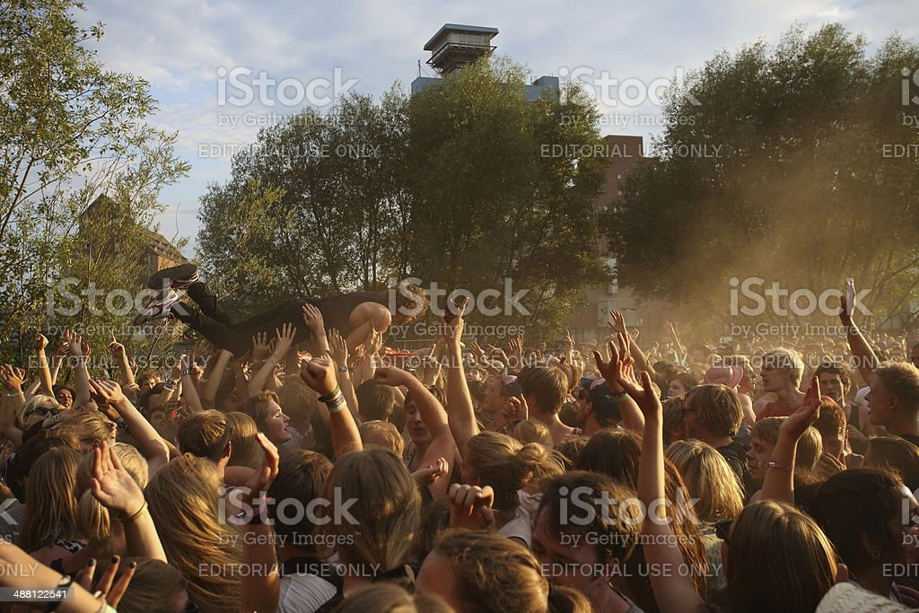 Stage dive during an open air concert stock photo