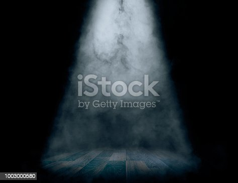 Stage with spot light and smoke effect