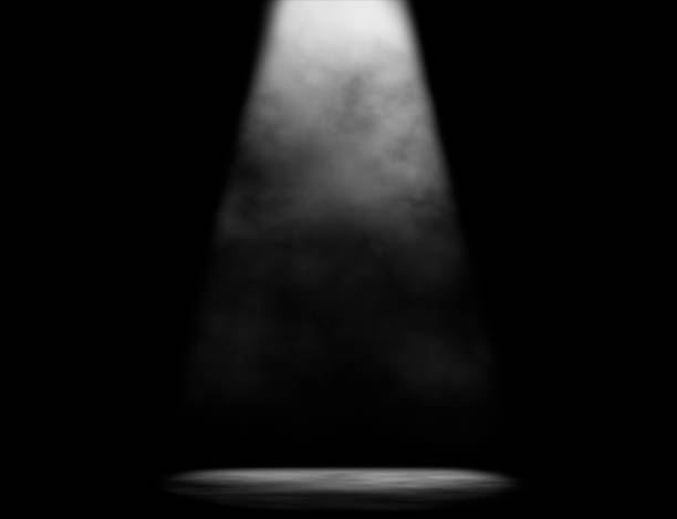 Stage Light Simple black and white composition of dark stage with one light beam spot lit stock pictures, royalty-free photos & images