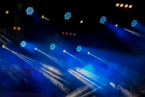 Stage Lighting During A Show On A Dark Background During A