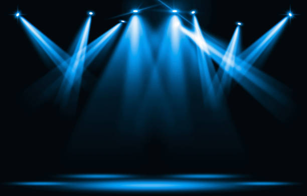Stage lights. Blue spotlight strike through the darkness. stock photo