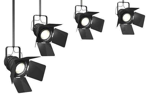 stage lights Four stage spotlights on a isolated on a white background.This is a detailed 3d rendering. stage light stock pictures, royalty-free photos & images