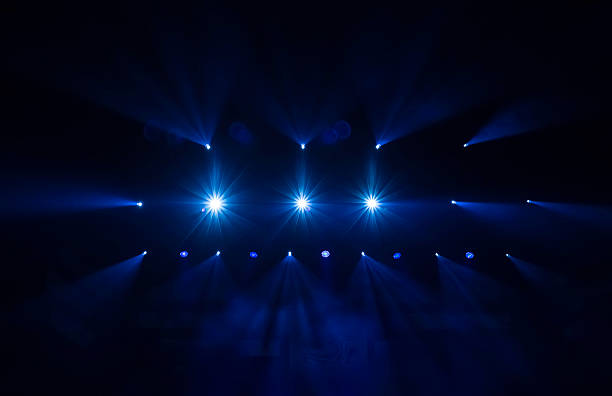 stage lights defocused stage lights/spotlights at the concert stage light stock pictures, royalty-free photos & images