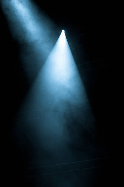 Stage Lights shining from a black background Microphone on stage, stage lights spot lit stock pictures, royalty-free photos & images