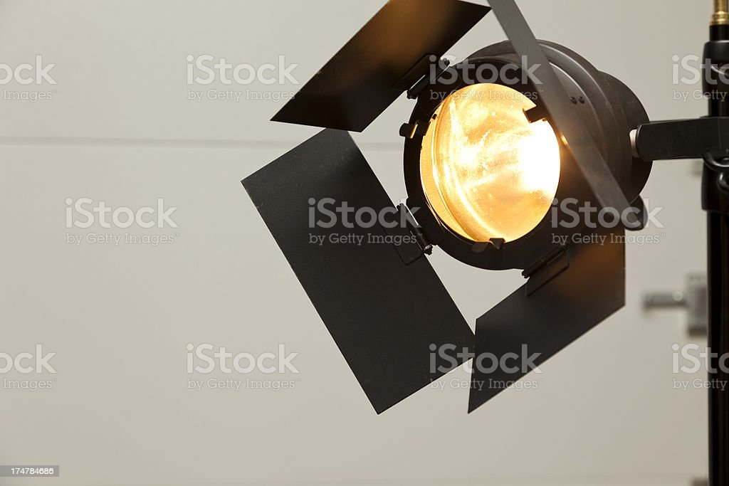 Stage Spotlight with wall in background.  Copy space. royalty-free stock photo