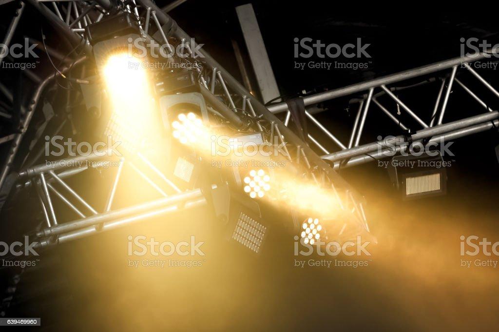 stage spotlights through smoke stock photo