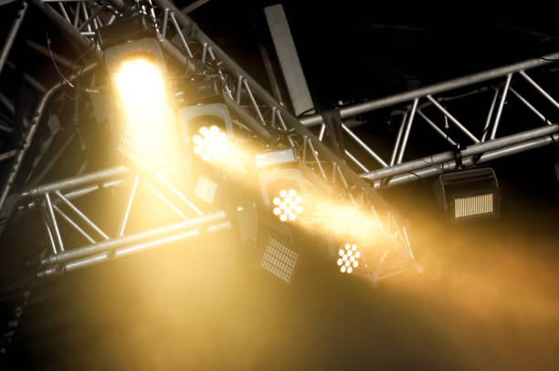 stage spotlights through smoke - foto de acervo