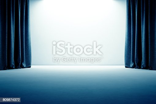 istock Stage with curtain, empty concrete floor and white wall background 809874372