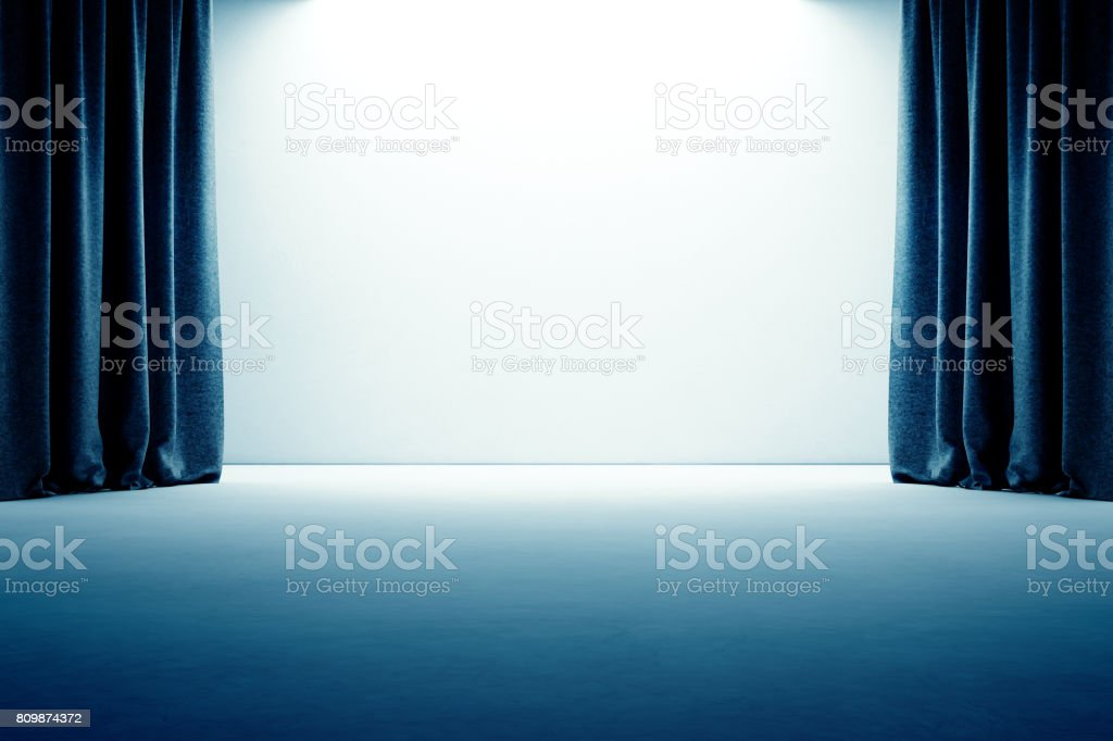 Stage with curtain, empty concrete floor and white wall background stock photo