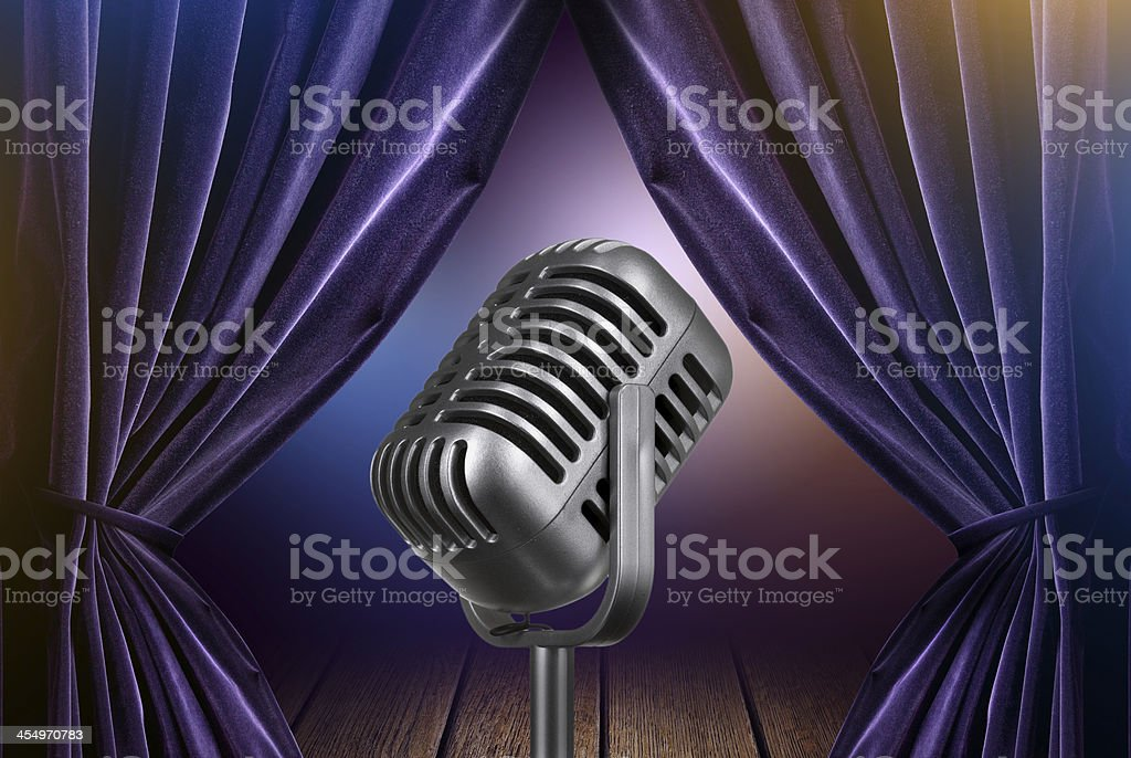stage with open curtains and microphone stock photo