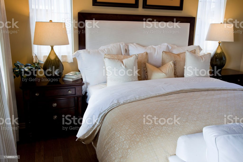 Staged photo of a well designed bedroom royalty-free stock photo