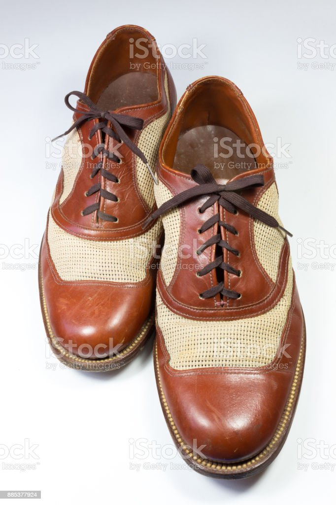 Staggered view of a pair of vintage men's shoes in brown leather, isolated on white stock photo
