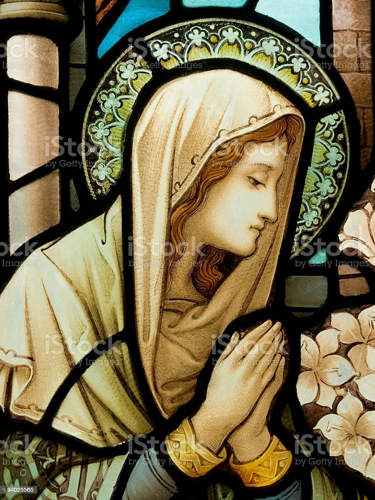 Stain glass window depiction of our lady stock photo