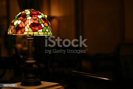Stained glass antique lamp in lightly lit room (shallow depth-of-filed).