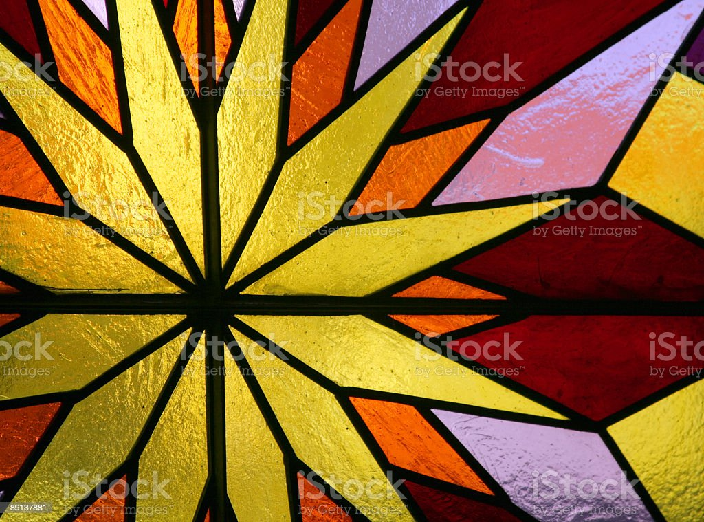 Stained glass featuring yellow sun royalty-free stock photo