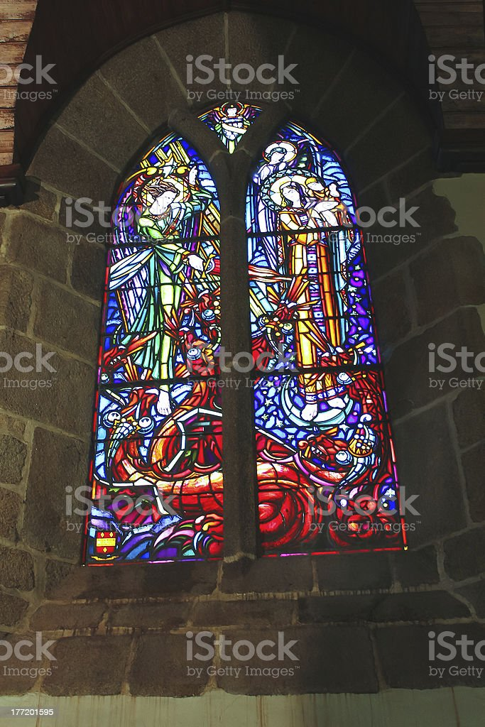 Stained glass In  abbey church  of Mont Saint Michel. Normand royalty-free stock photo