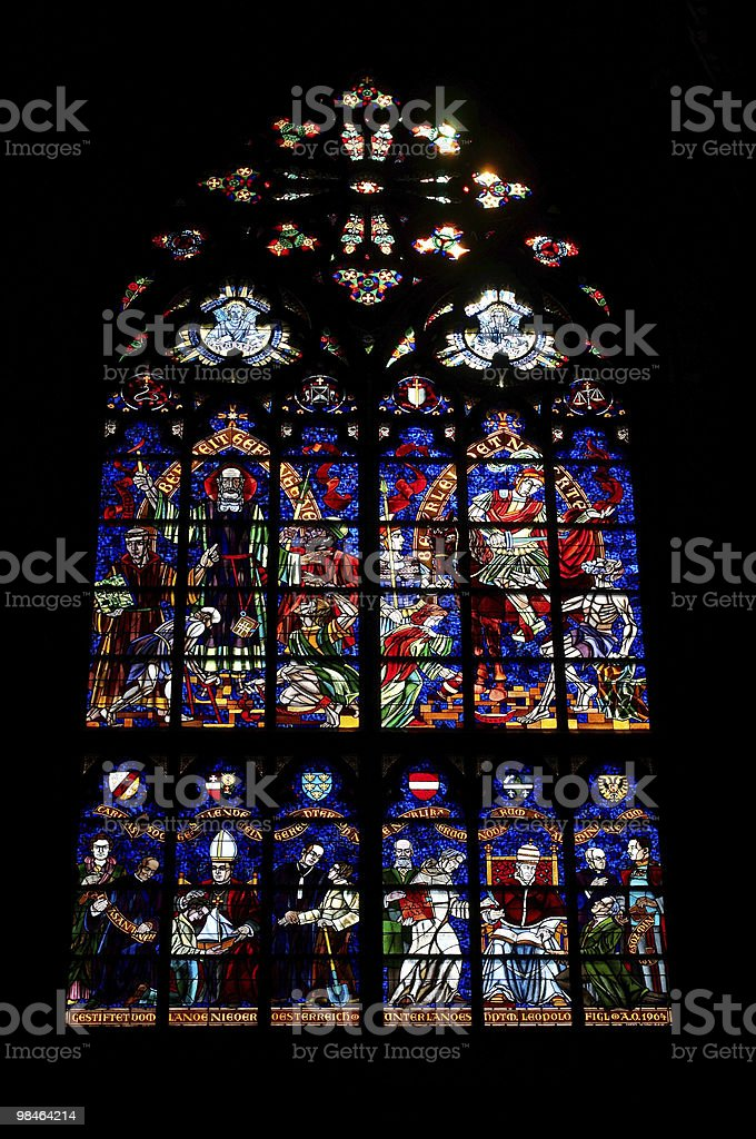 Stained glass in Votivkirche church royalty-free stock photo