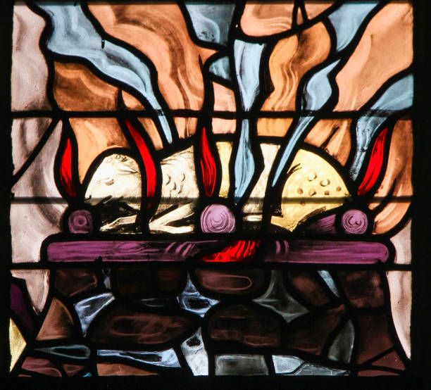 Stained Glass of a burning lamb, symbolizing the Agnus Dei stock photo
