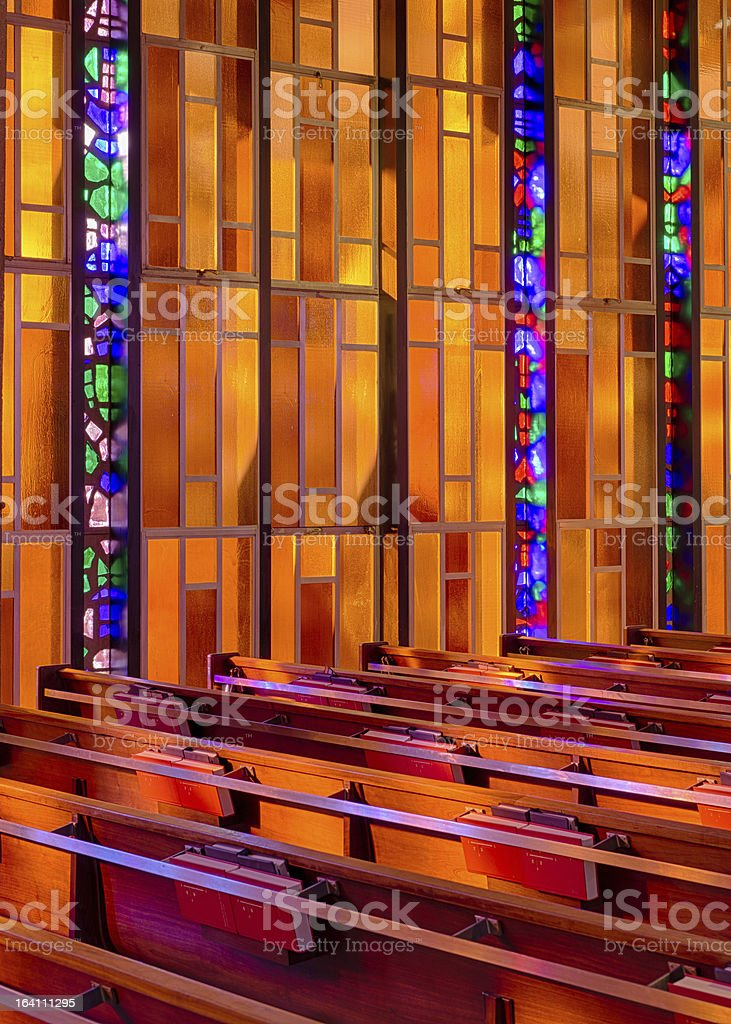 Stained glass pews royalty-free stock photo