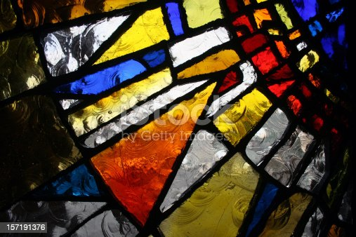Partial view of a modern stained glass window.