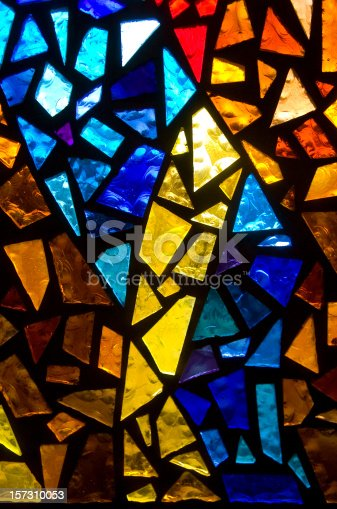 A close up on stained glass in a church.