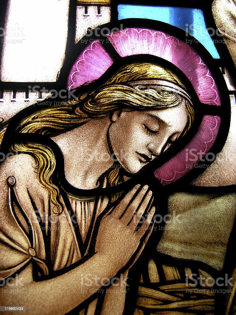 Stained glass prayer stock photo