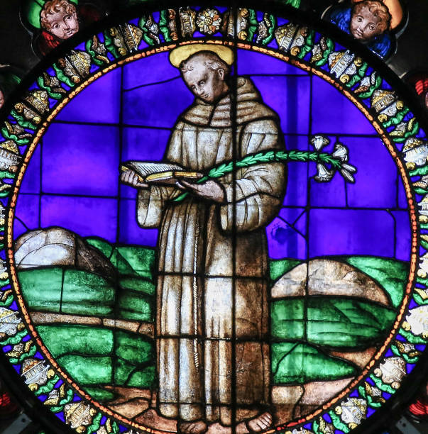 Stained Glass - Saint Anthony of Padua Stained Glass in the Basilica of San Petronio, Bologna, Emilia Romagna, Italy, depicting Saint Anthony of Padua or San Antonio, a famous Italian saint. st. anthony of padua stock pictures, royalty-free photos & images