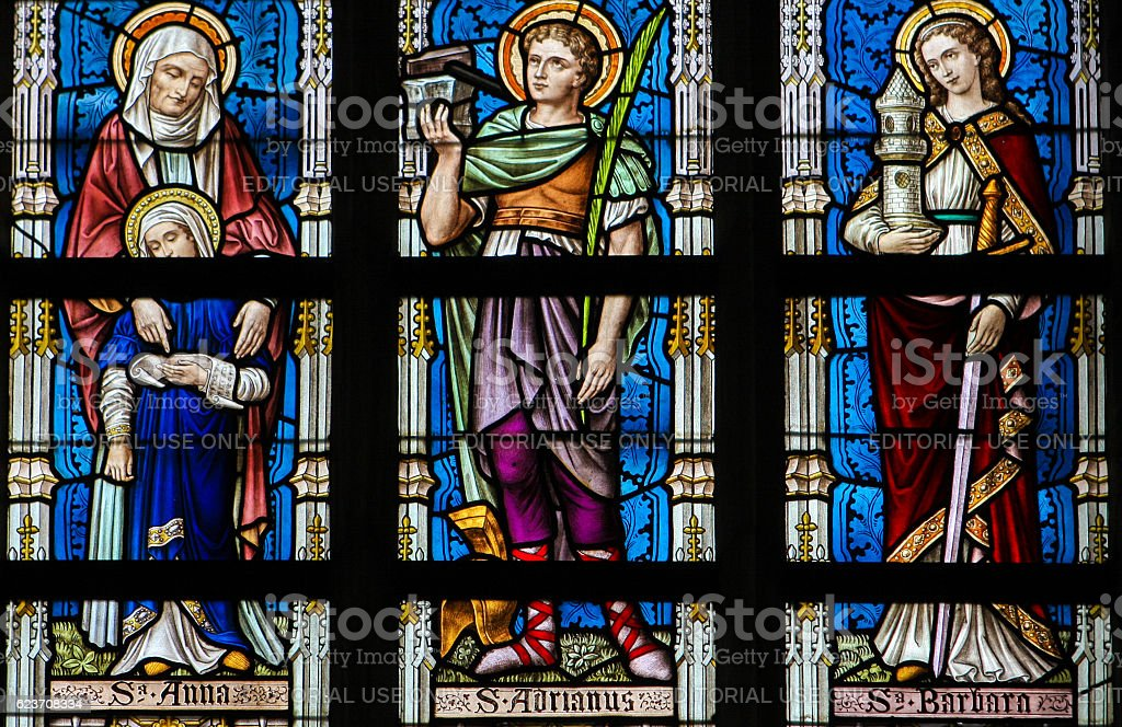 Stained Glass - Saints Ana, Adrian and Barbara stock photo