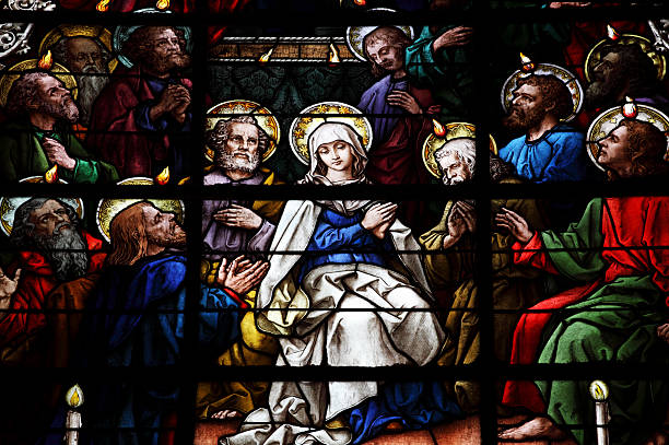 Stained Glass showing pentecost scene stock photo