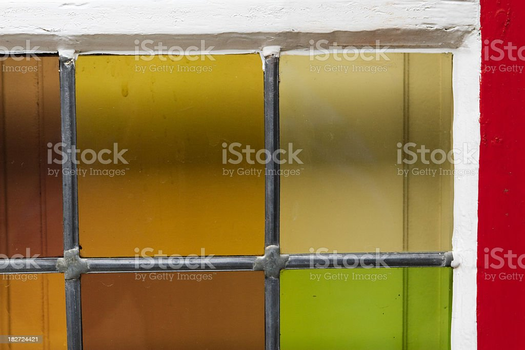 Stained glass squares in window royalty-free stock photo