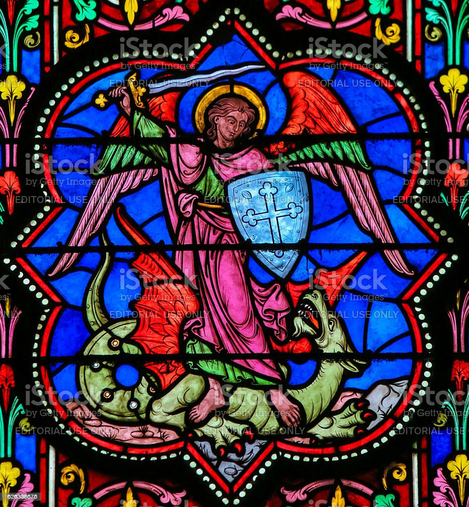 Stained Glass - the Archangel Michael vanquishing Satan stock photo