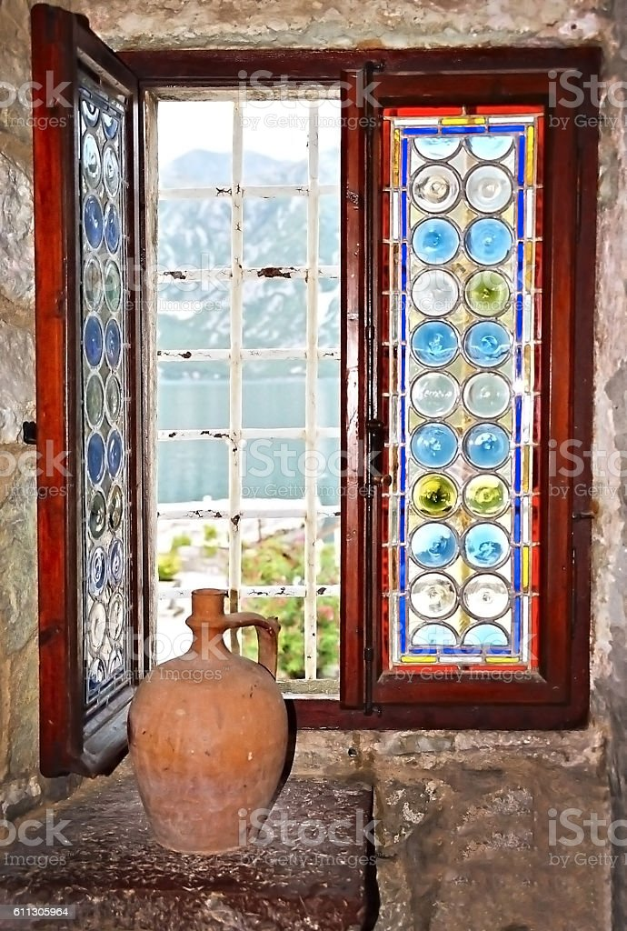 Stained glass window and old pitcher  in Montenegro stock photo