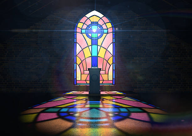 Stained Glass Window Church A dim old church interior lit by suns rays penetrating through a colorful stained glass window in the pattern of a crucifix reflecting colours on the floor and a speech pulpit pulpit stock pictures, royalty-free photos & images