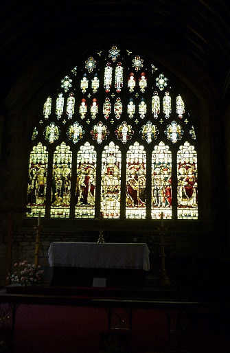 Stained Glass Window with dark background from inside a Church in Newent