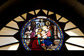 Birth of Jesus Christ scene in gothic frame. Linear drawing for coloring book. Vector illustration