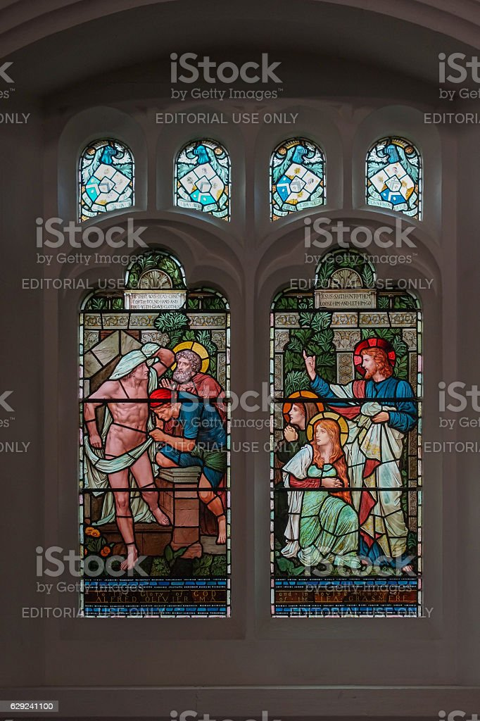 Stained glass window in Saint Oswald Church, Grasmere. stock photo