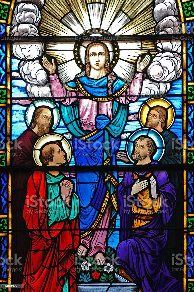 Stained glass window of Christ and his disciples stock photo