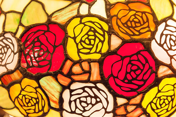 stained glass window of colorful roses for interior decoration. - rose window stock pictures, royalty-free photos & images